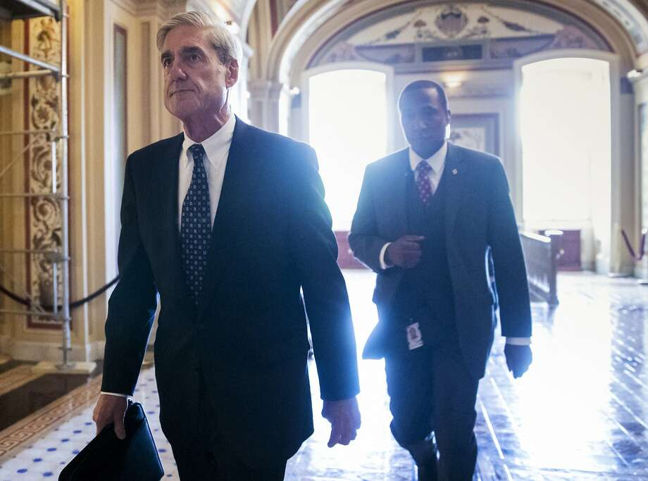 """FILE - In this June 21, 2017, file photo, special counsel Robert Mueller departs the Capitol after a closed-door meeting with members of the Senate Judiciary Committee about Russian meddling in the election and possible connection to the Trump campaign in Washington. The White House is continuing to deny that President Donald Trump is looking to oust Mueller. Spokesman Hogan Gidley tells reporters aboard Air Force One that, """"there are no conversations or discussions about removing"""" Mueller. (AP Photo/J. Scott Applewhite, File) Photo: J. Scott Applewhite / Associated Press"""