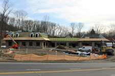 A new Monroe-based shooping center is under construction at 464 Main Street.