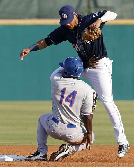 Midland Rockhounds' Jermaine Curtis slides safely into second base under San Antonio Missions' Fernando Tatis Jr. during the first inning in Game 5 of their Texas League South Division Championship series held Sunday Sept. 10, 2017 at Nelson W. Wolff Municipal Stadium. The Rockhounds won the game 4-1, and won the series. Photo: Edward A. Ornelas, Staff / San Antonio Express-News / © 2017 San Antonio Express-News