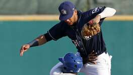 Midland Rockhounds' Jermaine Curtis slides safely into second base under San Antonio Missions' Fernando Tatis Jr. during the first inning in Game 5 of their Texas League South Division Championship series held Sunday Sept. 10, 2017 at Nelson W. Wolff Municipal Stadium. The Rockhounds won the game 4-1, and won the series.