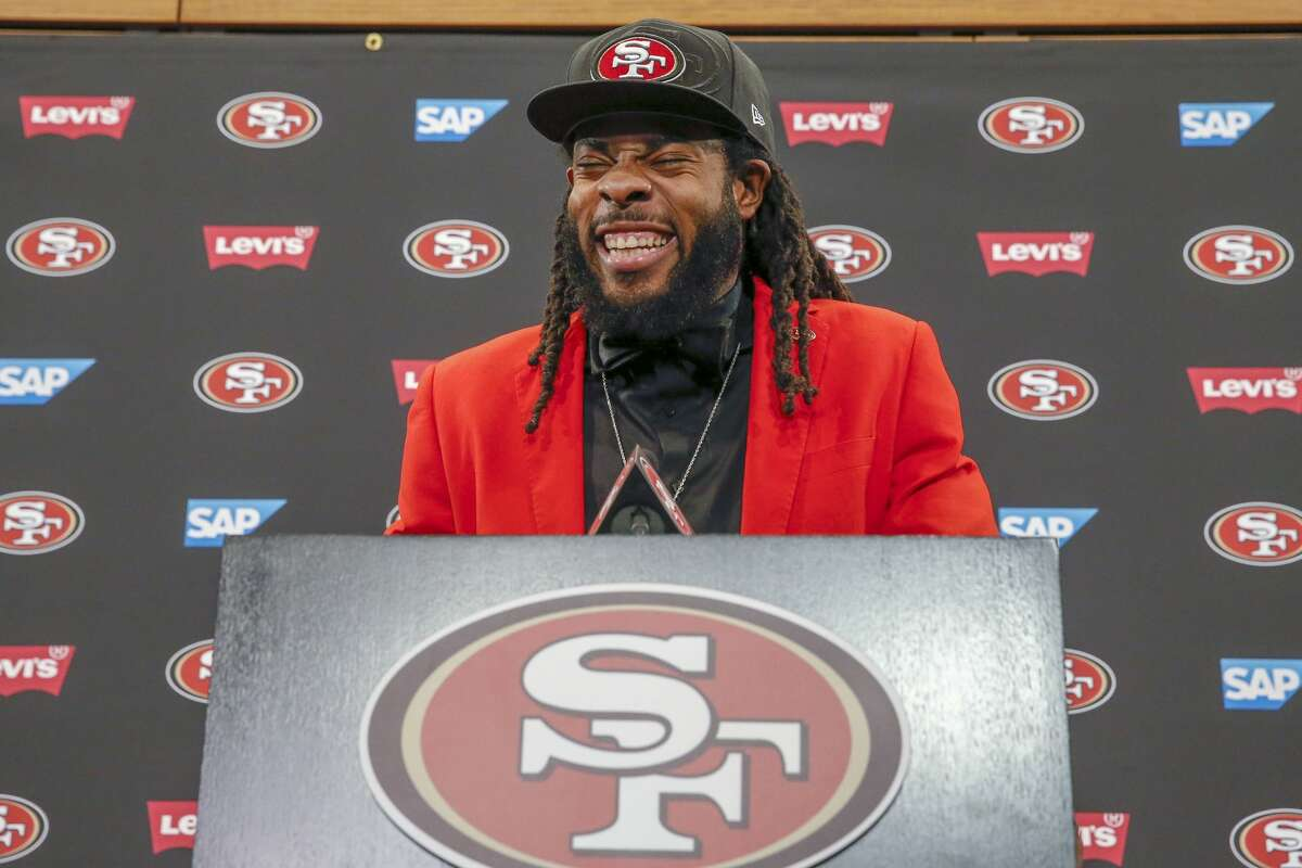 New San Francisco 49ers cornerback Richard Sherman laughs as he answers questions during an NFL football news conference in Santa Clara, Calif., Tuesday, March 20, 2018. Sherman agreed to a three-year deal with the 49ers.