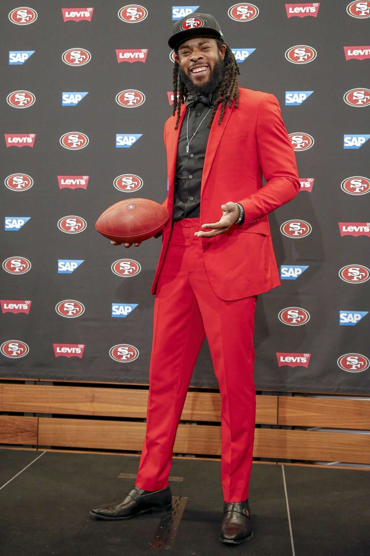 San Francisco 49ers cornerback Richard Sherman poses for a photo after answering questions during an NFL football news conference in Santa Clara, Calif., Tuesday, March 20, 2018. Sherman agreed to a three-year deal with the 49ers.