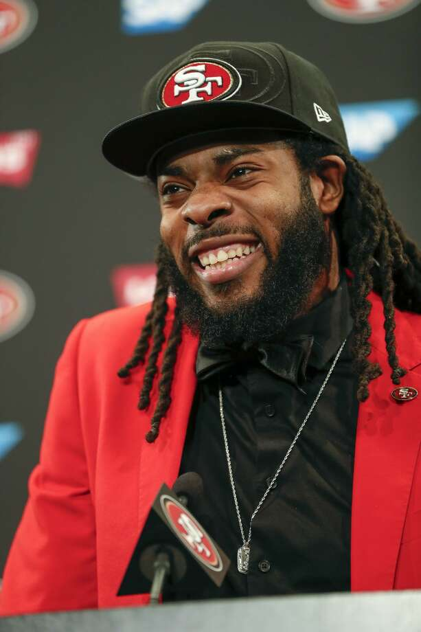 35b7c7f8209 New San Francisco 49ers cornerback Richard Sherman smiles as he answers  questions during an NFL football