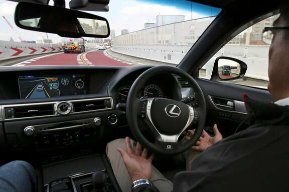 "An employee of Toyota Motor Corp., drives automated driving test vehicle during a test drive of Toyota's self-driving technologies in Tokyo, Tuesday, Oct. 6, 2015.  Toyota unveiled its vision for self-driving cars in a challenge to other automakers as well as industry newcomer Google Inc., promising to start selling such vehicles in Japan by 2020. Toyota Motor Corp. demonstrated on a regular Tokyo freeway Tuesday what it called the ""mobility teammate concept,"" meaning the driver and the artificial intelligence in a sensor-packed car work together as a team. (AP Photo/Koji Sasahara)"