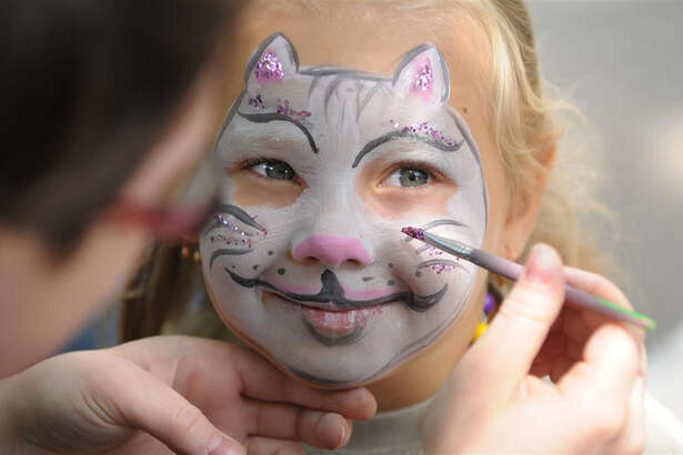Face painting at The Lawn's Grand Opening Showcase.