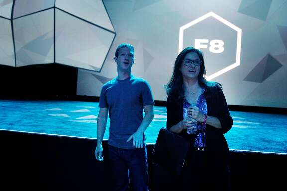 Mark Zuckerberg (l to r), Facebook chief executive officer, and Caryn Marooney Facebook VP of technology communications,  talk on the floor after the opening keynote at Facebook's F8 developers conference on Wednesday, April 30, 2014 in San Francisco, Calif.