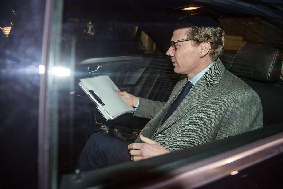 Cambridge Analytica CEO Alexander Nix leaves the company's offices Tuesday. The company announced he had been suspended amid questions  about the company's misuse of Facebook data. Photo: Chris J Ratcliffe, Bloomberg