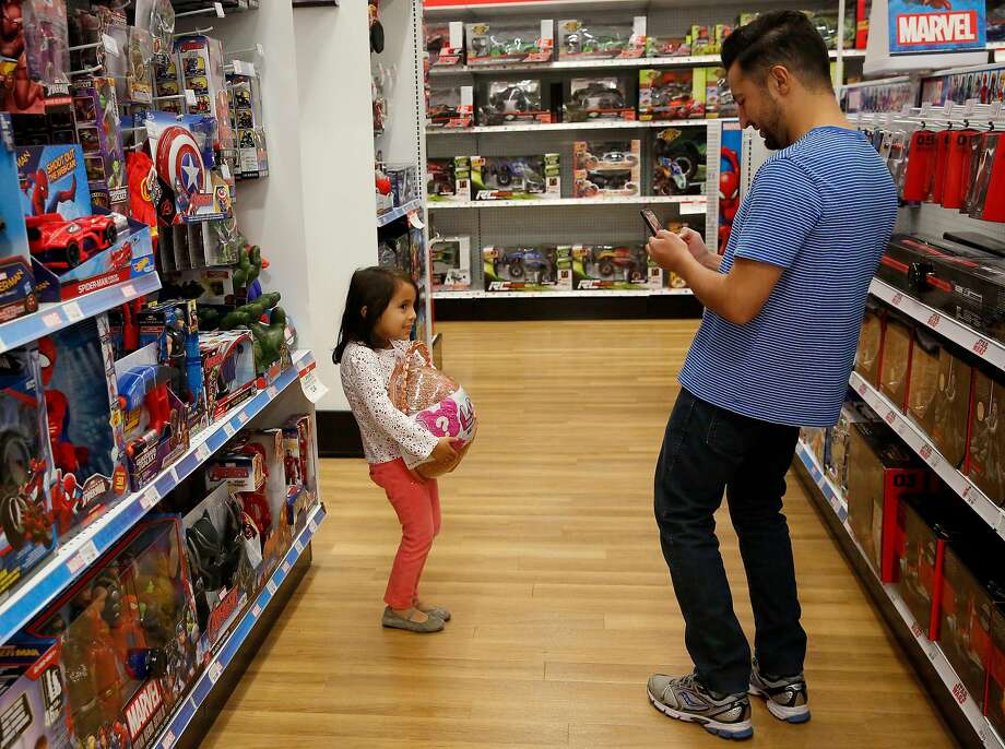 In the aisles of a Toys R Us. The company recently announced that it failed to survive bankruptcy and will close all of its U.S. stores. Photo: Guy Wathen, The Chronicle