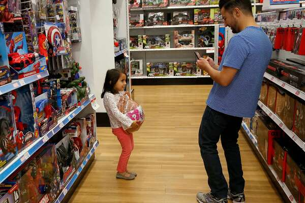 In the aisles of a Toys R Us. The company recently announced that it failed to survive bankruptcy and will close all of its U.S. stores.
