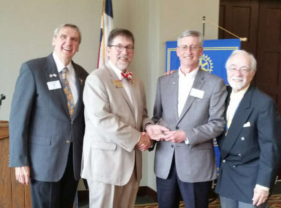 The Katy Rotary Club honored and recognized Dusty Thiele on March 15 as a Paul Harris Endowment Fellow for his contribution to Rotary International and support of Rotary's campaign to eradicate polio worldwide. From left are: George Yeiter, Katy Rotary member and past District 589 governor; Wally Kronzer, Rotary District 589 Rotary Foundation chair; Thiele, and David Frishman Katy Rotary member. Photo: Katy Rotary Club