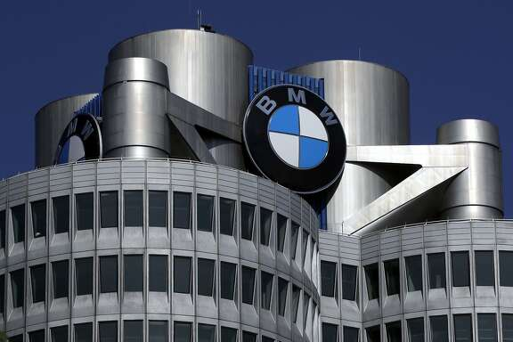 FILE - In this May 10, 2017 file photo the logo of German car manufacturer BMW visible at the headquarters in Munich, Germany. German prosecutors and police have searched offices at the Munich headquarters of automaker BMW on Tuesday, March 3, 2018 in connection with an investigation into suspected manipulation of diesel vehicle emissions.  (AP Photo/Matthias Schrader,file)