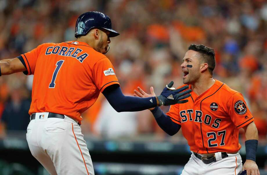Astros shortstop Carlos Correa (1) and second baseman Jose Altuve (27) have a solid statistical case for being MLB's best duo up the middle. Photo: Brett Coomer, Staff / © 2017 Houston Chronicle