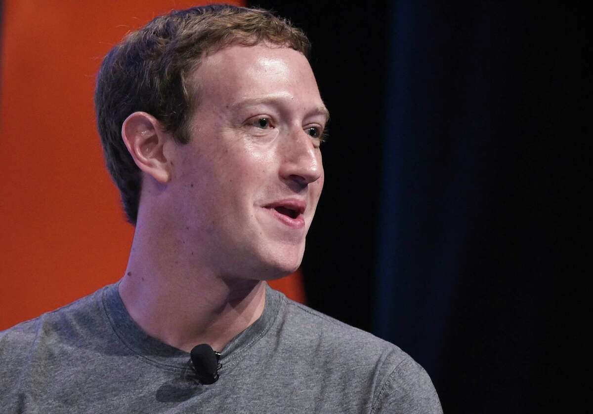 (FILES) In this file photo taken on June 24, 2016 Facebook CEO and founder Mark Zuckerberg speaks during a discussion at the Global Entrepreneurship Summit at Stanford University in Palo Alto, California. Facebook shares plunged March 19, 2018 as the social media giant was pounded by criticism at home and abroad over revelations that a firm working for Donald Trump's presidential campaign harvested and misused data on 50 million members.Calls for investigations came on both sides of the Atlantic after Facebook responded to explosive reports of misuse of its data by suspending the account of Cambridge Analytica, a British firm hired by Trump's 2016 campaign.Democratic Senator Amy Klobuchar and Republican John Kennedy called for Facebook chief Mark Zuckerberg to appear before Congress, along with Google and Twitter's CEOs. / AFP PHOTO / MANDEL NGANMANDEL NGAN/AFP/Getty Images