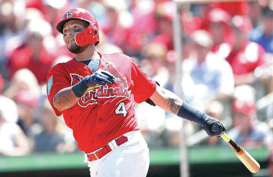 The Cardinals' Yadier Molina drives in a run with a double in the fifth inning of a spring training game Friday against the Miami Marlins in Jupiter, Fla.