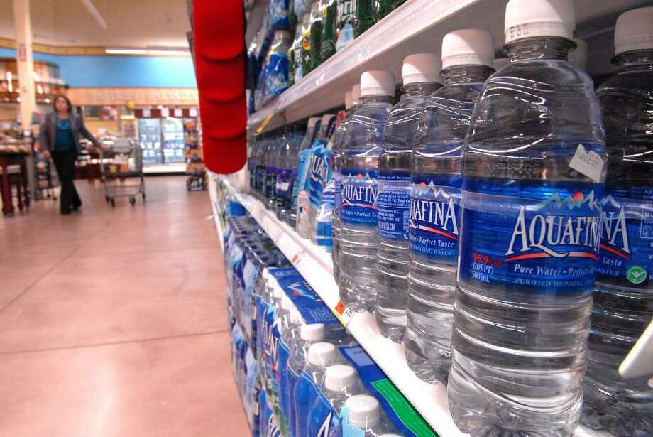 A nickel deposit will be levied on each bottle of water starting Saturday, but retailers have until Nov. 8 to dispose of non-deposit bottles of water. Photo: PAUL BUCKOWSKI