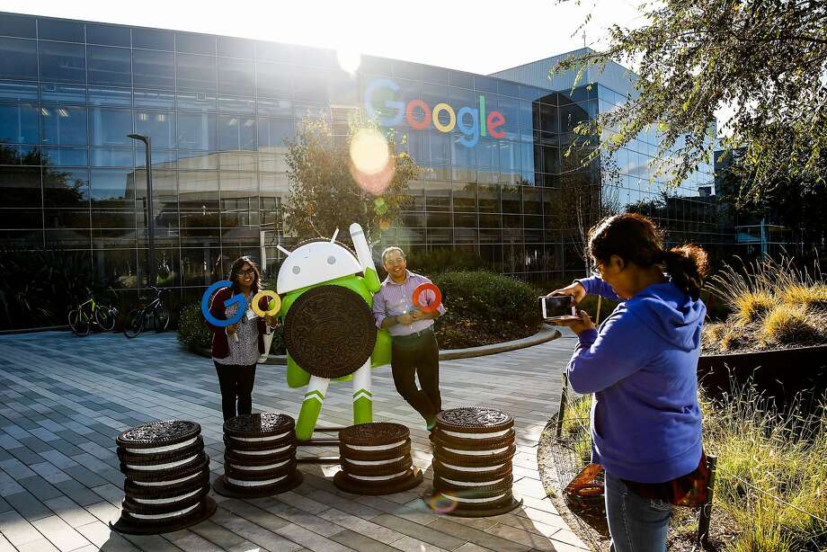 Sonia Jahid photographs friends Amrita Banerjee and Dipta Biswa (center) at Google, one of many firms with trust issues. Photo: Gabrielle Lurie / The Chronicle 2017