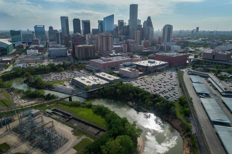 The Buffalo Bayou bends around the Harris County Jail after being joined by White Oak Bayou at Allen's Landing next to the University of Houston Downtown, Monday, March 19, 2018, in Houston. A proposed canal would cut across the area north of the jail and connect White Oak Bayou to Buffalo Bayou sooner, hopefully mitigating flooding risk upstream.  Mark Mulligan / Houston Chronicle ) Photo: Mark Mulligan, Houston Chronicle / © 2018 Houston Chronicle