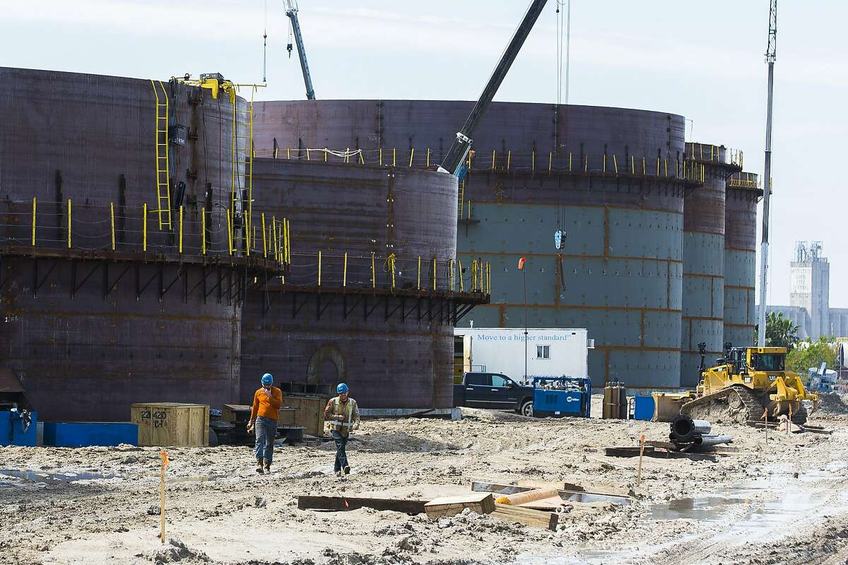 New oil storage tanks are built for an additional oil export facility at the Port of Corpus Christi, Wednesday, March 7, 2018, in Corpus Christi. CONTINUE to see the world's largest oil refineries.