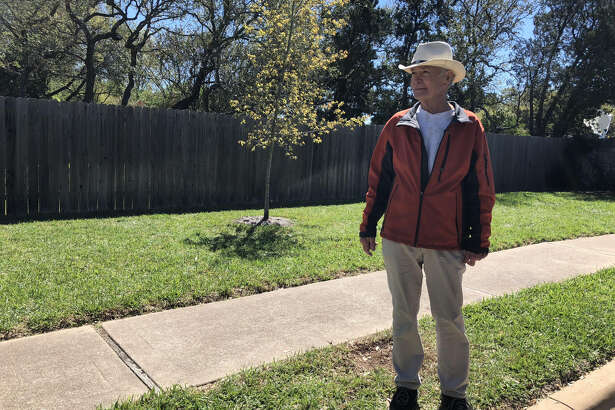 Travis Country resident Jerome Schmidt stands near the site of a blast that detonated Sunday in Austin. The explosion was one of five to hit the city since March 2.