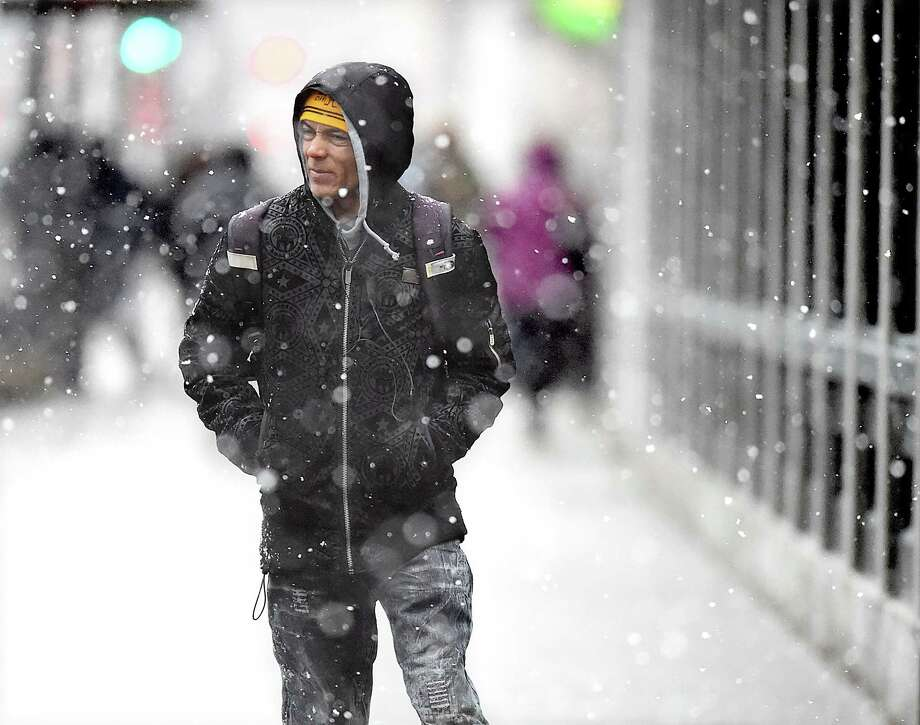 A man walks on Church Street in New Haven during the noreaster March 7. Photo: Catherine Avalone / Hearst Connecticut Media / New Haven Register