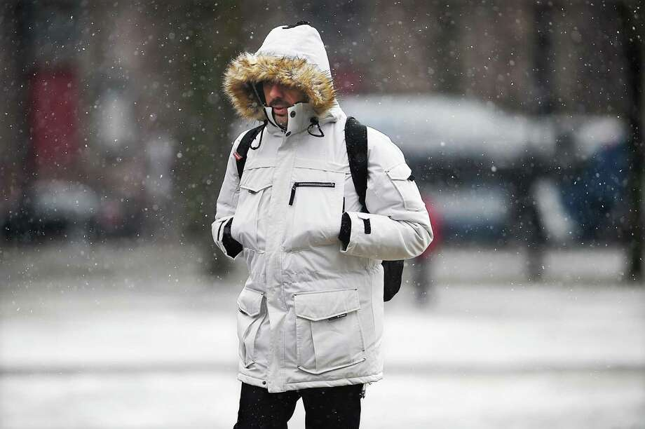 A man makes his way across the New Haven Green during the noreaster March 7. Photo: Catherine Avalone / Hearst Connecticut Media / New Haven Register