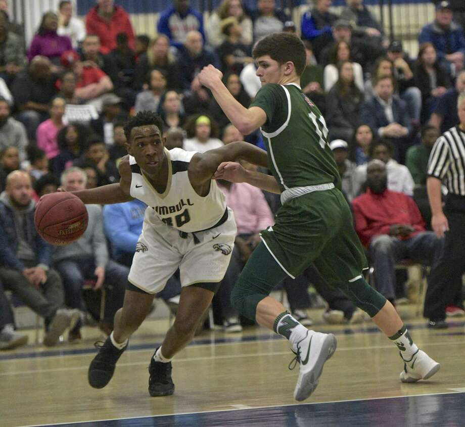 Trumbull's Timmond Williams (30) drives around Norwalk's Connor Mastropietro (11) in the boys FCIAC basketball semifinal game between Norwalk and Trumbull high schools, at Wilton High School, in Wilton, Conn. Tuesday, February 27, 2018. Photo: H John Voorhees III / Hearst Connecticut Media / The News-Times