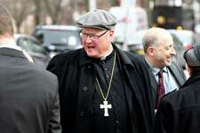 Cardinal Timothy Dolan says his goodbyes outside the Capitol on State Street after meeting with the governor on Tuesday, March 20, 2018, in Albany, N.Y. Dolan met to talk about the Child Victims Act. (Will Waldron/Times Union)