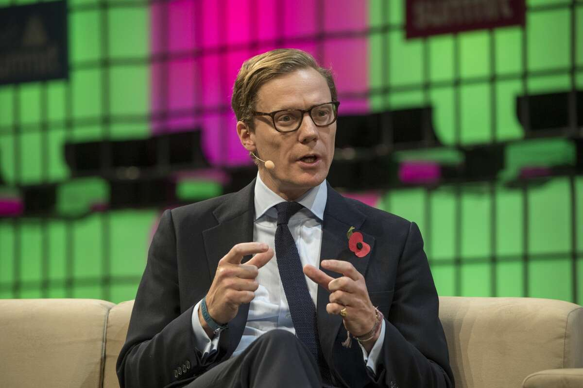 """Alexander Nix, CEO, Cambridge Analytica, answers Matthew Freud, Founder and Chairman, Freuds, questions about """"From Mad Men to Math Men"""" during the final day of Web Summit in Altice Arena on November 09, 2017 in Lisbon, Portugal. After days of silence, Facebook CEO Mark Zuckerberg finally responded to revelations that a third party misused millions of users' personal data."""