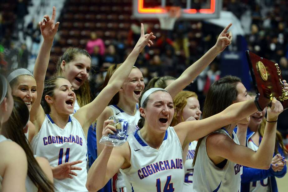 Members of the Coginchaug girls basketball team celebrate their win in the Class S championship game on Saturday in Uncasville. Photo: Dave Phillips, For Hearst Connecticut Media