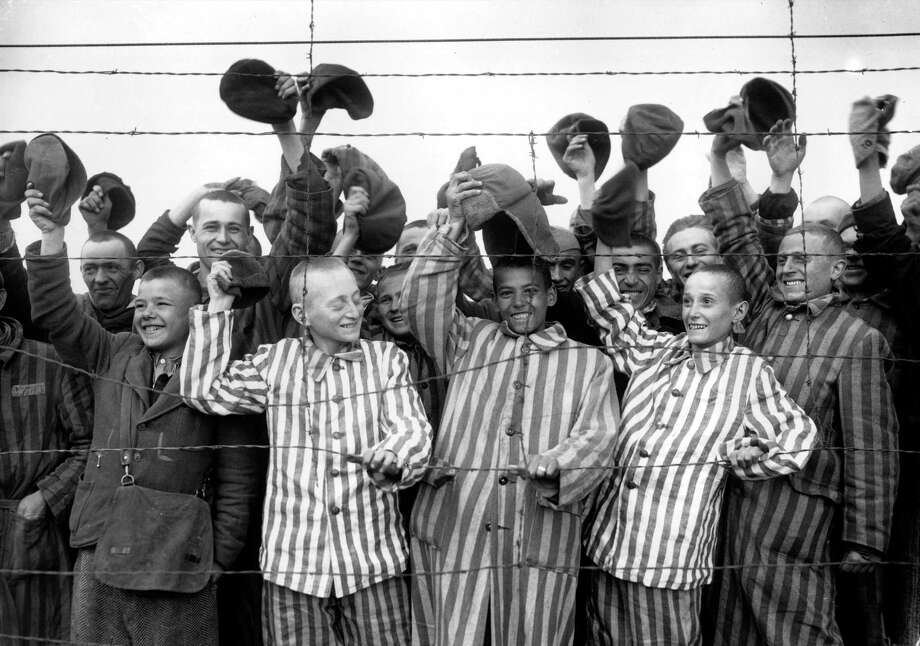 During and after WWII, we were the country that with ideals and ferocity defeated pure evil, the kind that imprisoned Jews and others at Dachau. Here the prisoners cheer their liberators of the 42nd Rainbow Division of the 7th U.S. Army in May 1945. Trump has taken all that idealism and striving for a better world away. Photo: JIM PRINGLE /AP / 1945 AP
