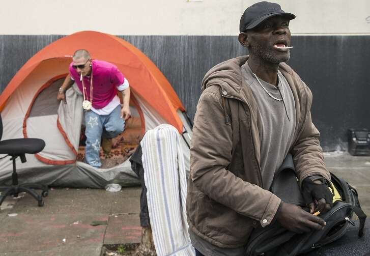 TJ calls toward a friend while standing at a homeless encampment near the corner of Florida and Treat streets Tuesday, March 20, 2018 in San Francisco, Calif.