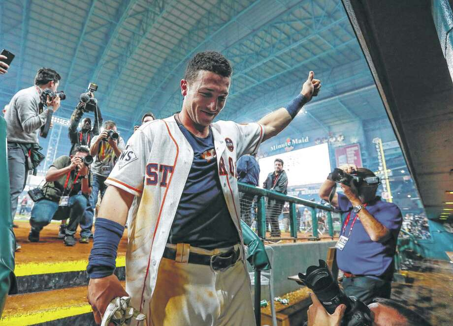 Houston Astros third baseman Alex Bregman (2) enters the Astros dugout after hitting a walk off single that drove in pinch runner Derek Fisher and gave the Astros a 13-12 win over the Los Angeles Dodgers in the tenth inning of Game 5 of the World Series at Minute Maid Park on Monday, Oct. 30, 2017, in Houston. ( Karen Warren / Houston Chronicle ) Photo: Karen Warren, Staff / © 2017 Houston Chronicle