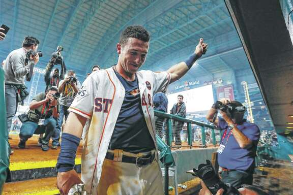 Houston Astros third baseman Alex Bregman (2) enters the Astros dugout after hitting a walk off single that drove in pinch runner Derek Fisher and gave the Astros a 13-12 win over the Los Angeles Dodgers in the tenth inning of Game 5 of the World Series at Minute Maid Park on Monday, Oct. 30, 2017, in Houston. ( Karen Warren / Houston Chronicle )