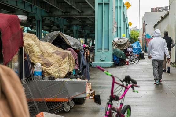 Multiple tents make up a small homeless encampent along 13th Street near Harrison Street Tuesday, March 20, 2018 in San Francisco, Calif.