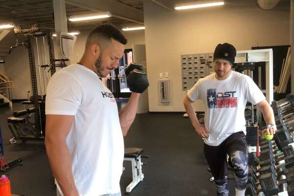 "DST, a Houston-based sports training company that includes clients such as Astros player Carlos Correa, shown with trainer Garrett Kelly, is opening its first stand-alone facility in Webster on April 1. ""It will be our own location,"" Kelley said. ""So, we can pretty much train around the clock, in season and out of season."""