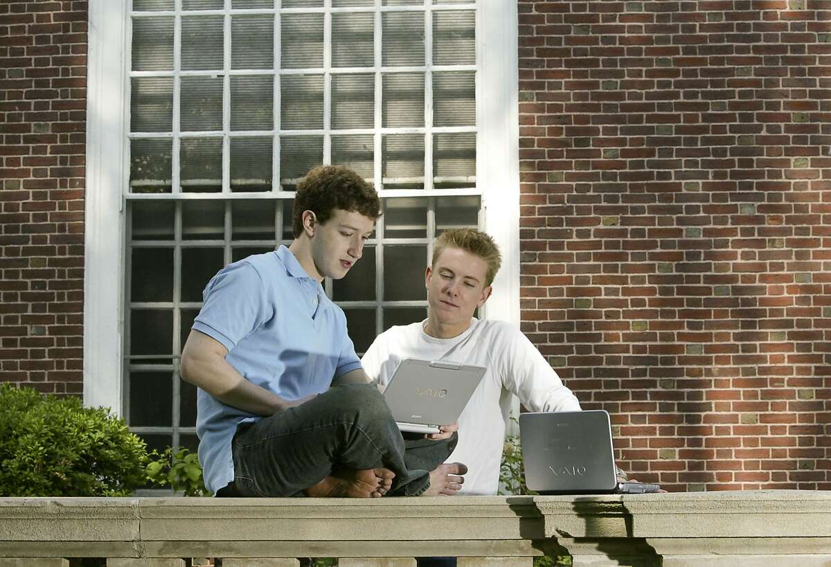 """Mark Zuckerberg (L) and Chris Hughes (R) creaters """"Facebook"""" photographed at Eliot House at Harvard University, Cambridge, MA. on May 14, 2004. Facebook was created in February 2004, 3 months prior to this photograph. (Photo by Rick Friedman/Corbis via Getty Images)"""