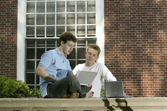 "Mark Zuckerberg (L) and Chris Hughes (R) creaters ""Facebook"" photographed at Eliot House at Harvard University, Cambridge, MA. on May 14, 2004. Facebook was created in February 2004, 3 months prior to this photograph. (Photo by Rick Friedman/Corbis via Getty Images)"