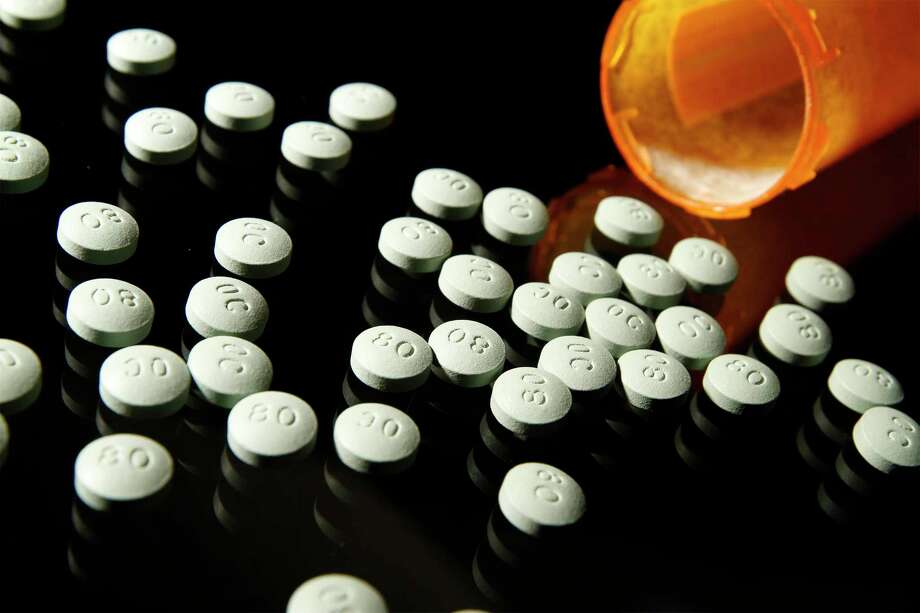 OxyContin, in 80 mg pills, in a 2013 file image. A recent trial suggests opioids had no pain-relieving adventage over common painkillers in a yearlong trial. (Liz O. Baylen/Los Angeles Times/TNS) Photo: Liz O. Baylen, MBR / Los Angeles Times