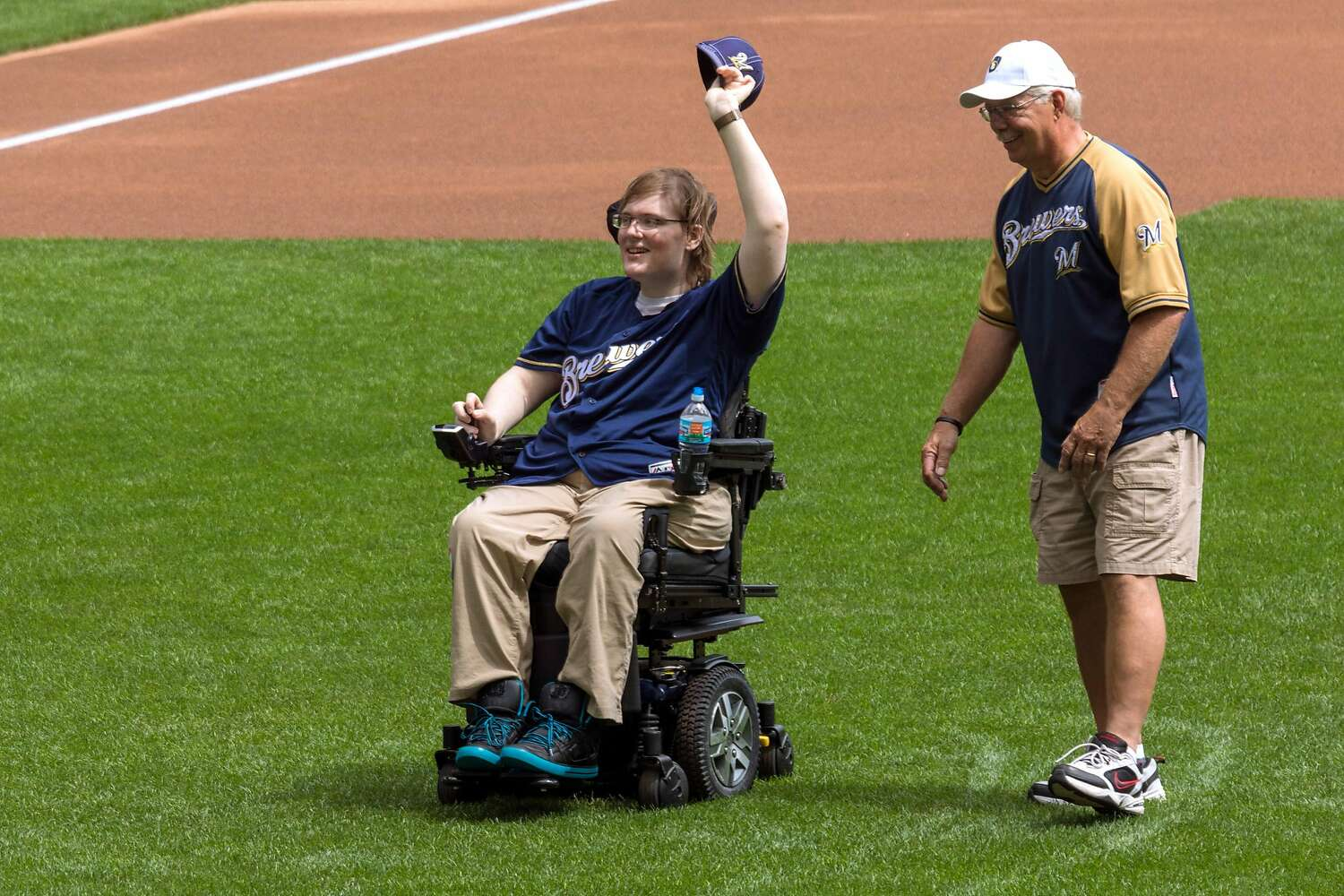 Lucas Lindner after throwing the first pitch in a baseball game.