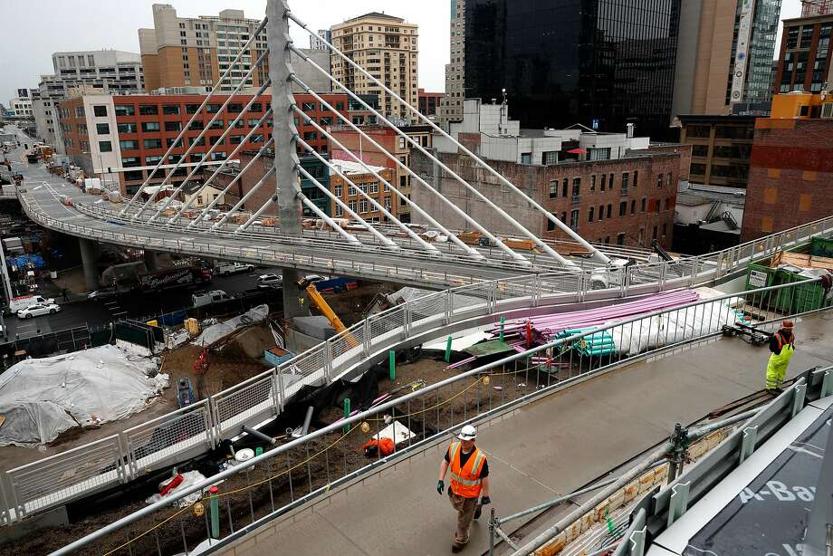 Buses will use the suspension bridge to enter and exit the structure, as construction continues on the Transbay Transit Center in downtown San Francisco, Calif., as seen on Tues. March 20, 2018. A big grand opening of the $2.2 billion project is already being planned for sometime in June. Below: Several skylights illuminate the bus deck as construction continues on the Transbay Transit, Center in downtown San Francisco, Calif., as seen on Tues. March 20, 2018. A big grand opening of the $2.2 billion project is already being planned for sometime in June. Photo: Michael Macor, The Chronicle