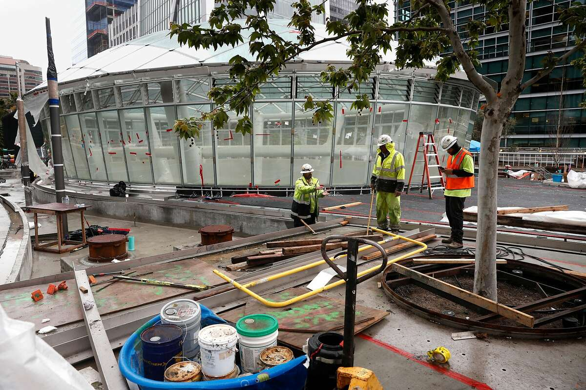 Workers on the terrace level with the oculus skylight above the grand hall is seen as construction continues on the Transbay Transit, Center in downtown San Francisco, Calif., as seen on Tues. March 20, 2018. A big grand opening of the $2.2 billion project is already being planned for sometime in June.