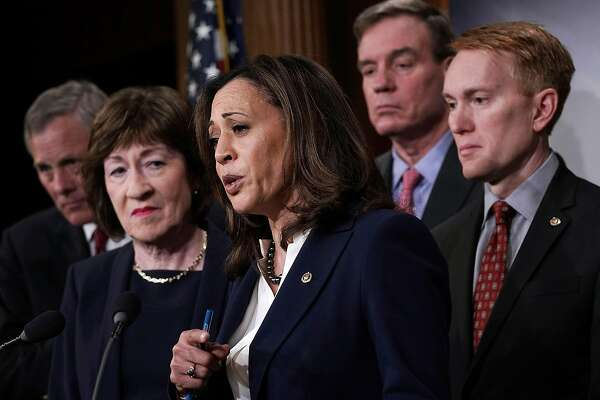 WASHINGTON, DC - MARCH 20:  U.S. Sen. Kamala Harris (D-CA) (3rd L) speaks as (L-R) Chairman of Senate Intelligence Committee Sen. Richard Burr (R-NC), Sen. Susan Collins (R-ME), committee Vice Chairman Sen. Mark Warner (D-VA) and Sen. James Lankford (R-OK) listen during a news conference at the Capitol March 20, 2018 in Washington, DC. The committee held a news conference to present findings and recommendations on threats from election infrastructure.  (Photo by Alex Wong/Getty Images)