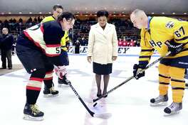 (Arnold Gold-New Haven Register) New Haven Mayor Toni Harp drops the puck for a ceremonial face off with John Twohill (left) of the New Haven Fire Department and Tom Glynn (right) of the New Haven Police Department at the 20th Anniversary 2016 Chief's Cup Hockey Game at Ingalls Rink in New Haven on 3/26/2016.
