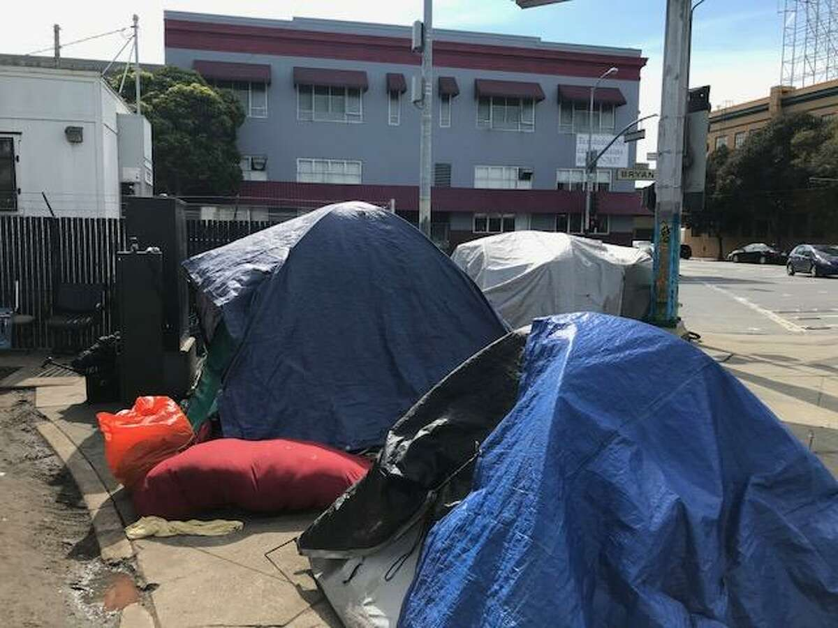 A homeless camp has sprouted this winter across the street from Multi-Service Center South, the biggest shelter in San Francisco. Many of the tent campers say they found it hard to either accept or find roofs this winter as the city tried to move 1,000 homeless people indoors.