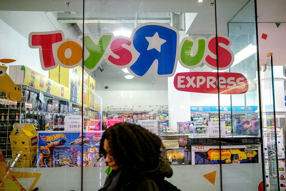 Toys r us postpones going out of business sales to friday sfgate a pedestrian passes in front of a toys r us store in new york on march spiritdancerdesigns Image collections