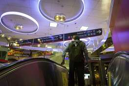Unique lighting fixtures and new signage greet a visitor to Terminal D at Bush Intercontinental Airport as they leave an escalator from security, Tuesday, March 20, 2018, in Houston. The airport recently received a 4-star rating from Skytrax, making Houston one of just two cities in the world with two airports with an above-four-star-rating from Skytrax. ( Mark Mulligan / Houston Chronicle )