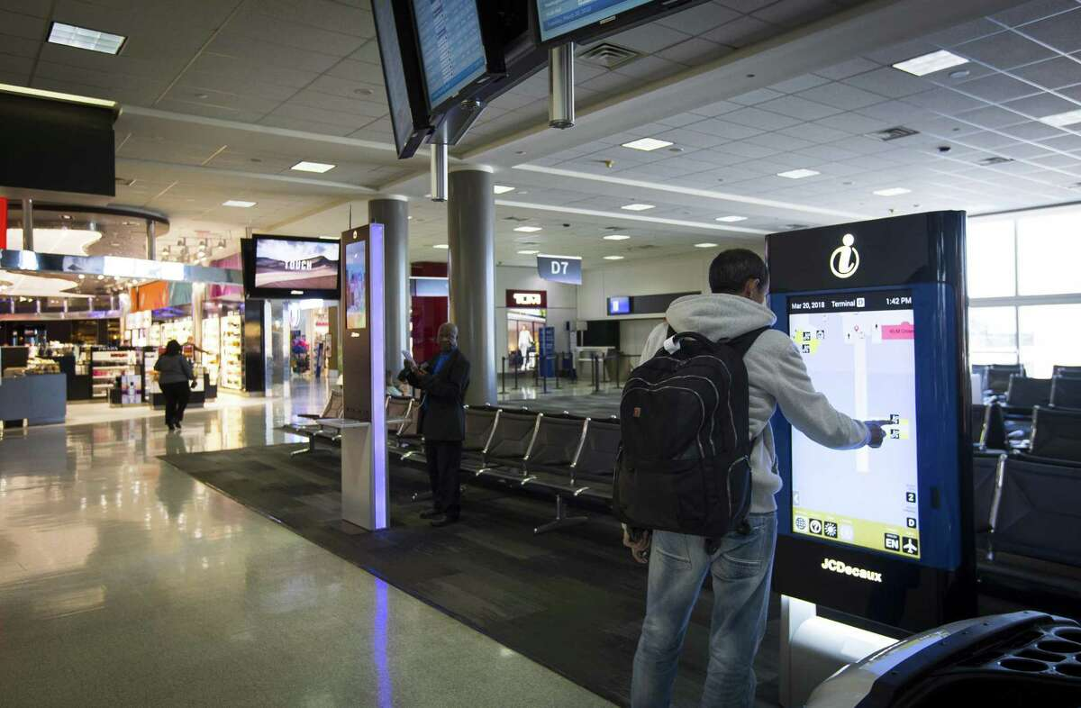 An interactive, electronic way-finding kiosk is used by a visitor in Terminal D at Bush Intercontinental Airport, Tuesday, March 20, 2018, in Houston. The airport recently received a 4-star rating from Skytrax, making Houston the first U.S. city to have two airports with a 4-star rating from Skytrax.( Mark Mulligan / Houston Chronicle )