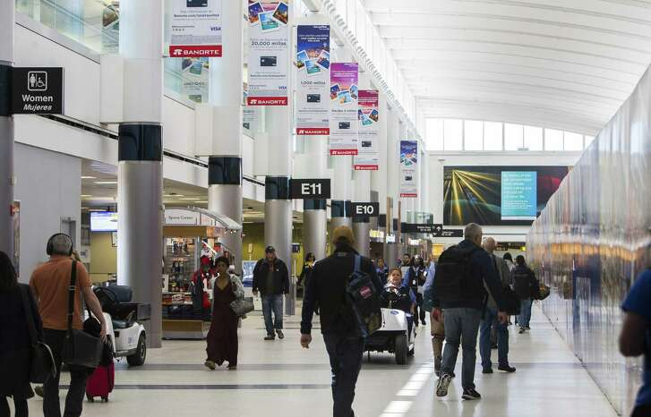 Travelers walk through Terminal E at Bush Intercontinental Airport, Tuesday, March 20, 2018, in Houston. The airport recently received a 4-star rating from Skytrax, making Houston one of just two cities in the world with two airports with an above-four-star-rating from Skytrax. ( Mark Mulligan / Houston Chronicle )