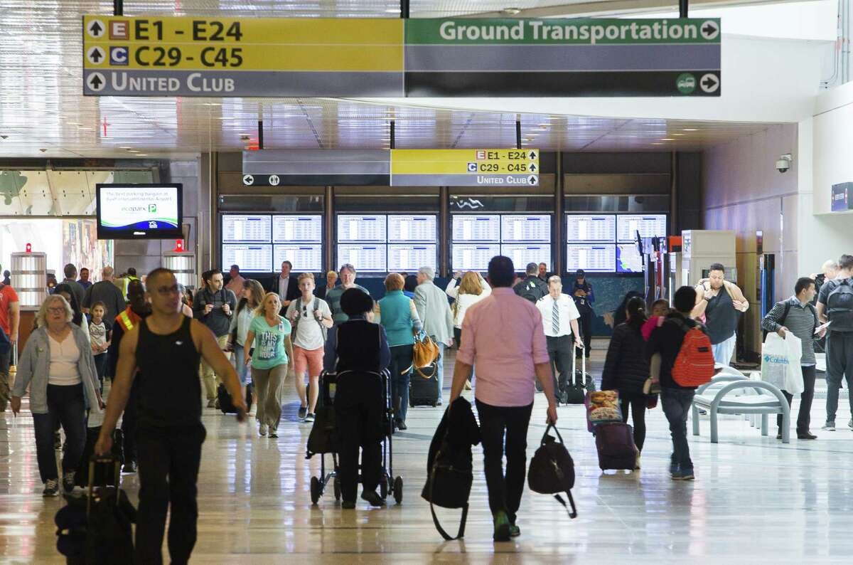 Travelers walk through Terminal E at Bush Intercontinental Airport, Tuesday, March 20, 2018, in Houston. CONTINUE to see the airports with the highest customer satisfaction rankings from J.D. Power & Associates.