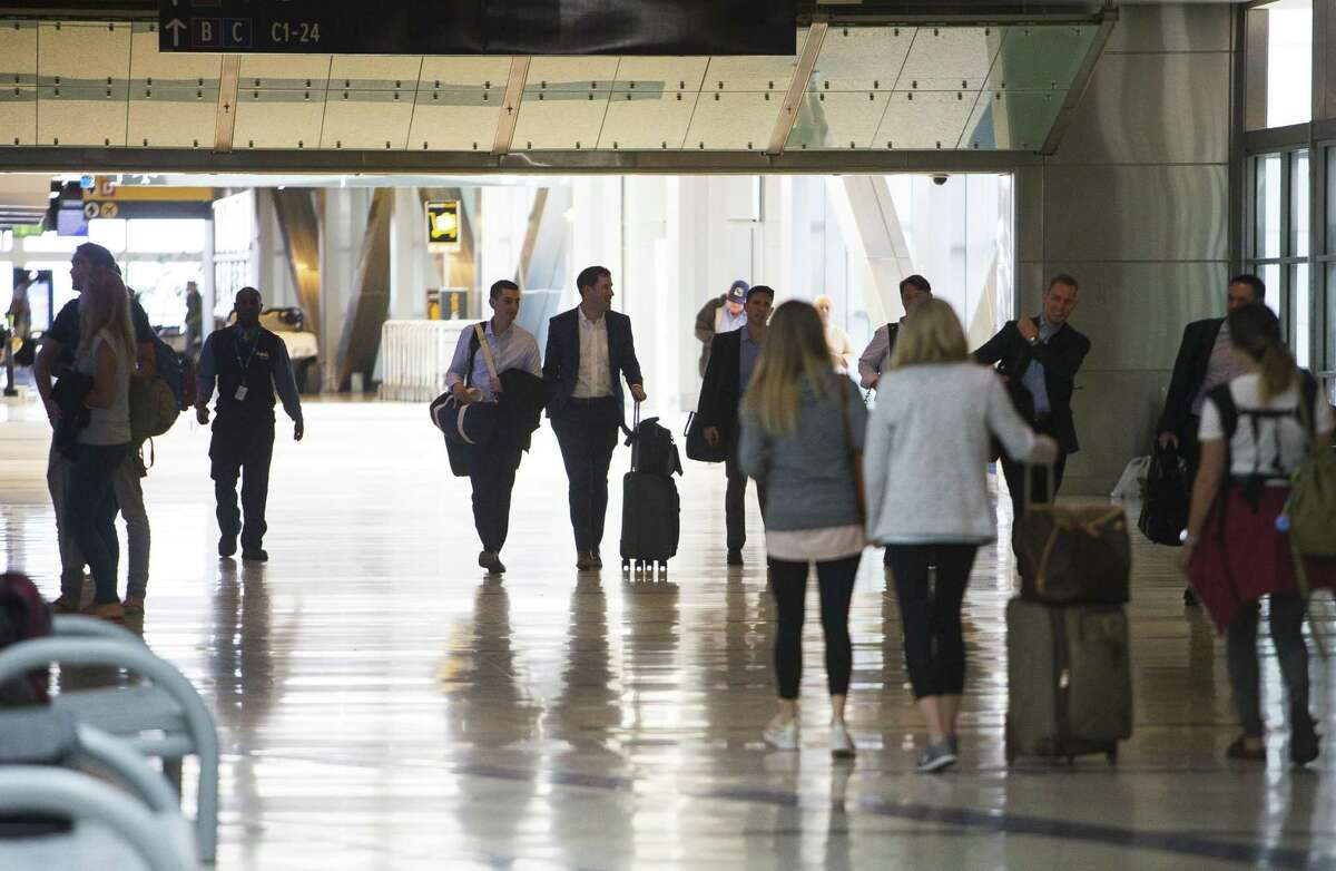 Travelers move through Bush Intercontinental Airport, Tuesday, March 20, 2018, in Houston. The airport recently received a 4-star rating from Skytrax, making Houston one of just two cities in the world with two airports with an above-four-star-rating from Skytrax. ( Mark Mulligan / Houston Chronicle )